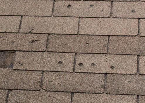 Hail Damage Woodbridge, VA | Damaged roof repair in Woodbridge, VA New shingle installation