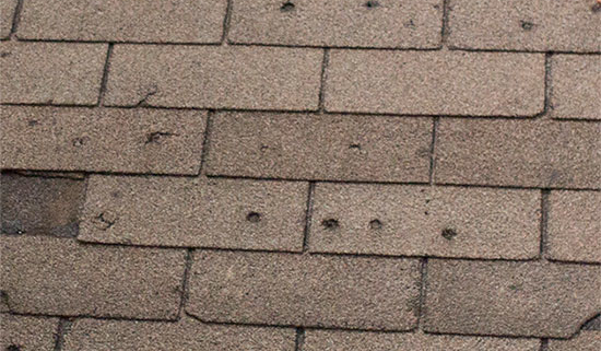 Hail Damage Woodbridge, VA | Damaged roof repair in Woodbridge, VA New shingle installation